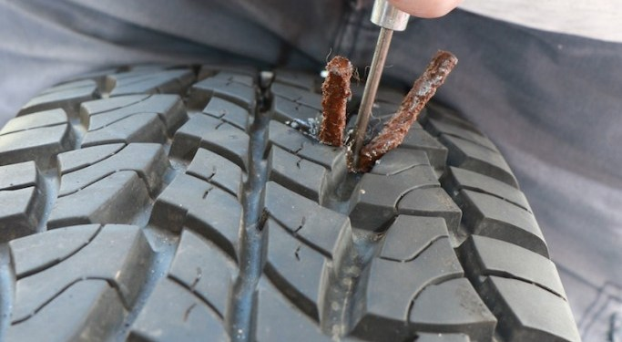 Push the loaded insertion needle into the hole in the tyre