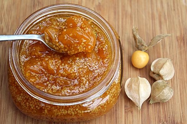 Open jar of homemade husk cherry jam