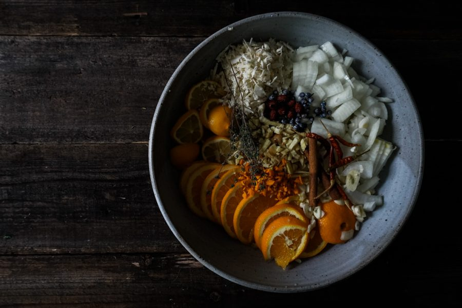 Fire cider ingredients prepared in a bowl before infusing