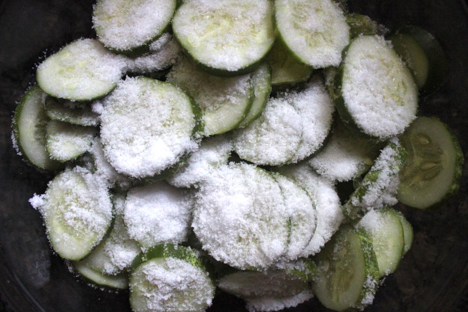 Soaking cucumber slices in salt