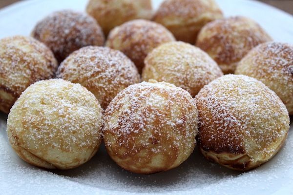 Aebleskiver dusted with powdered sugar