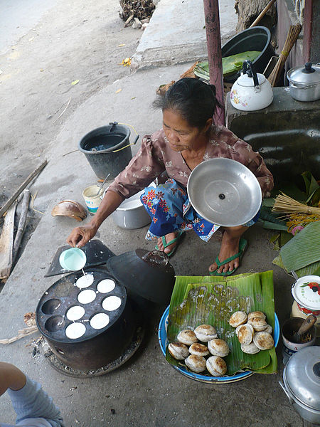 A woman making Serabi in Indonesia.