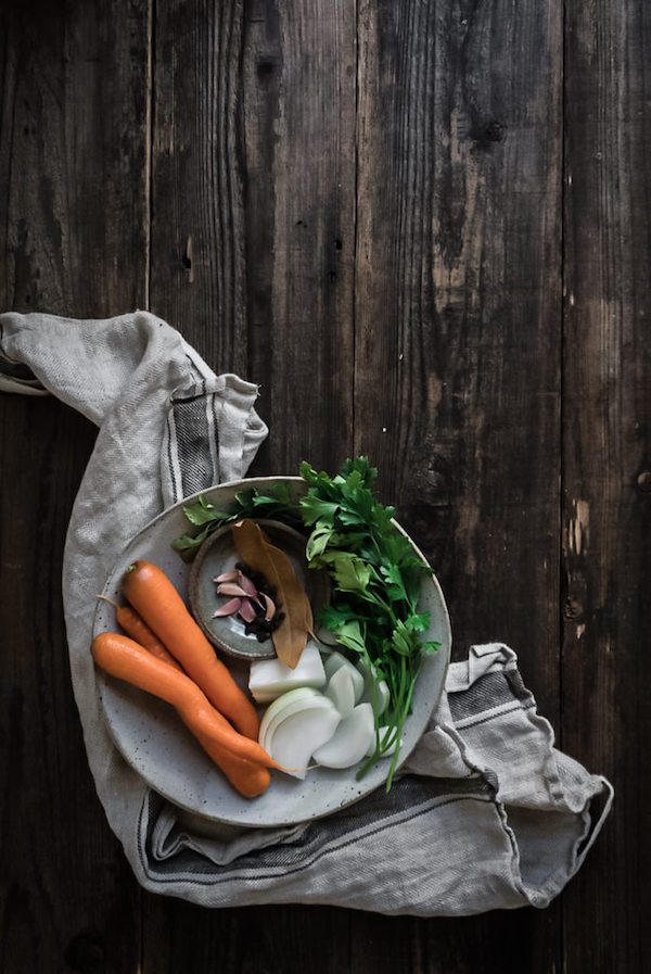 a bowl of carrots, onions, parsley and spices