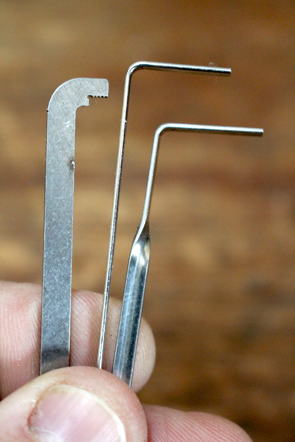 Various tension wrenches for lock picking, the most basic one is in the center.