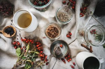 Ingredients for rose hip immunity tea spread out on a table.