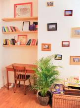 A reading nook and board games in the lounge at Kabas Hostel in Antwerp, Belgium.