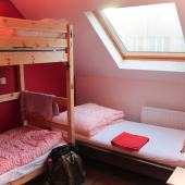 Cozy dorm room beds at Kabas Hostel in Antwerp, Belgium.