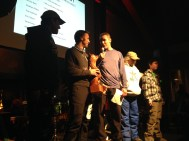 Derek receiving the Michael Wells Inspirational Award from Chris Klug