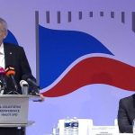 Milos Zeman standing on podium with Tomio Okamaru at SPD rally