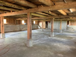 Lower level of prairie bells barn with freshly poured concrete.