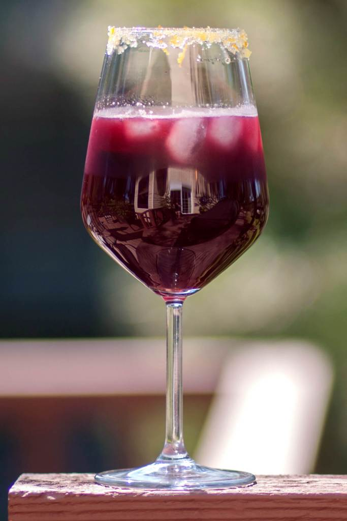 A glass of Black Raspberry Sangria is perfect for a hot summer day