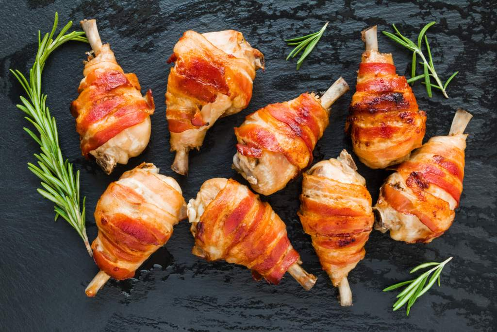 Prosciutto-Wrapped Duck Bites on a serving platter.