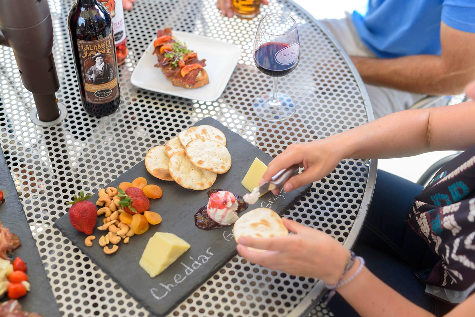 Enjoy a cheese board on one of our two patios overlooking Black Elk Peak