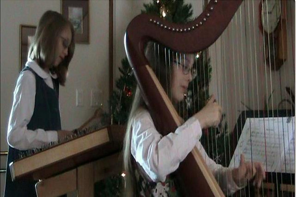 Planxty Irwin and Silent Night on Harp and Dulcimer by Kaira and Kendra. 12/09Music Arranged by Alice Freeman