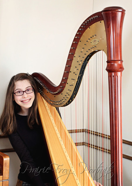 Kaira with her new pedal harp