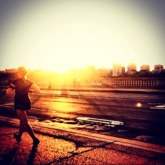 Running along the Arlington Memorial Bridge at sunset