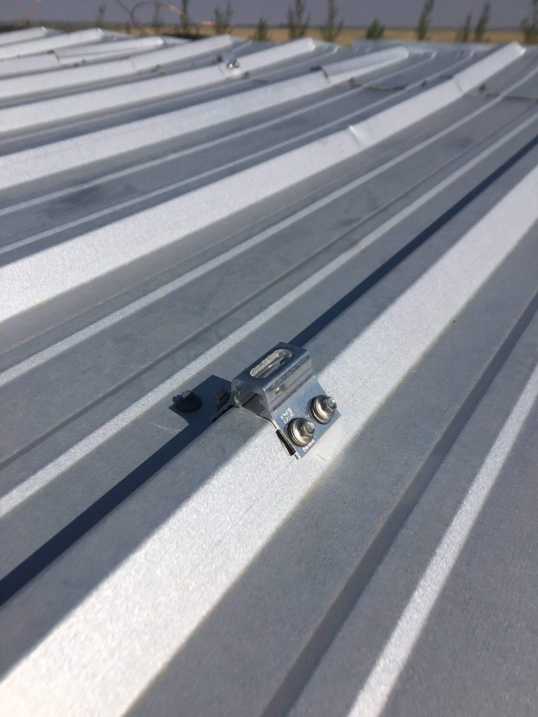 anchoring down solar panels on a metal roof