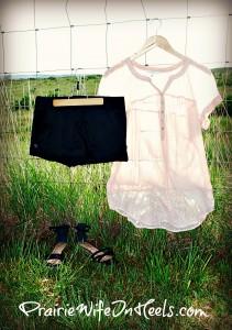 Sheer Blouse and Black Shorts