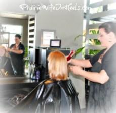 Hairstylist straightening hair