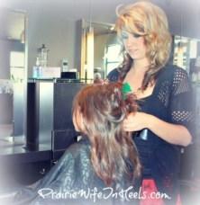 Hairstylist doing little girls hair
