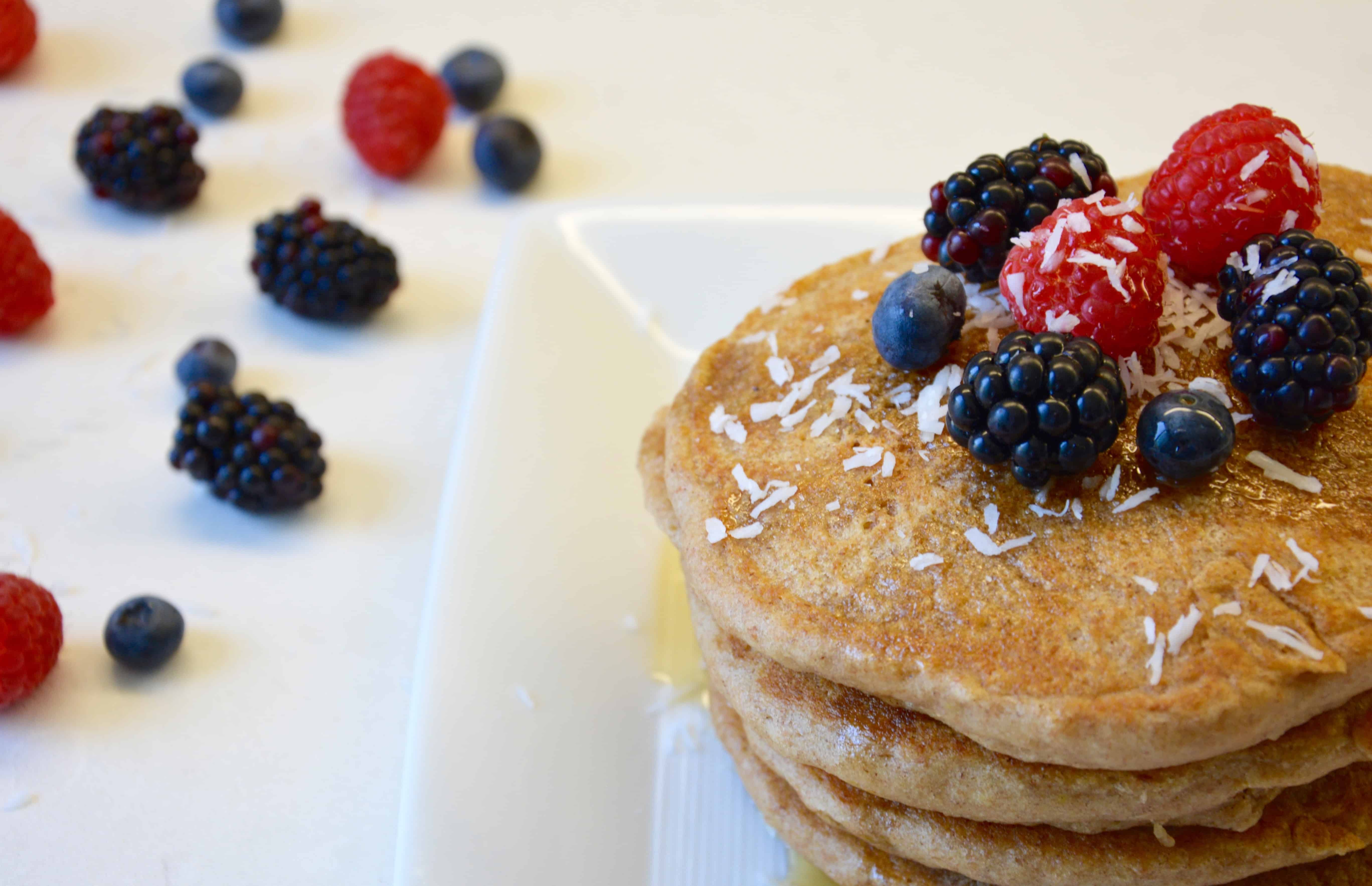 Coconut Milk Pancakes Topped with Maple Syrup and Berries