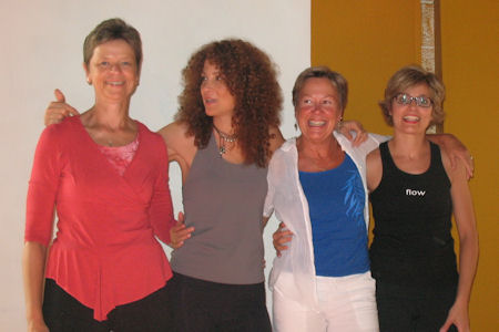 Photo of four yoga teachers