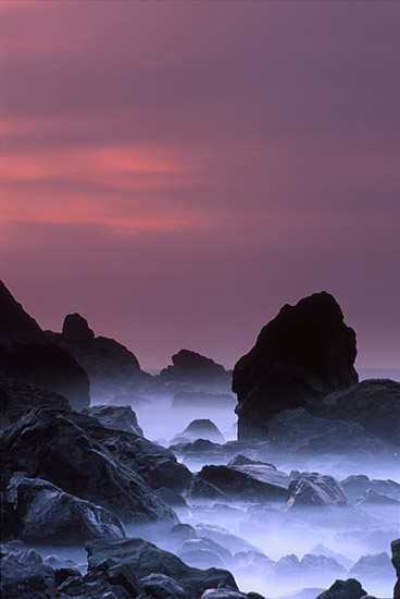 Photo: mist hovers close to shoreline and rocks at Muir Beach, CA