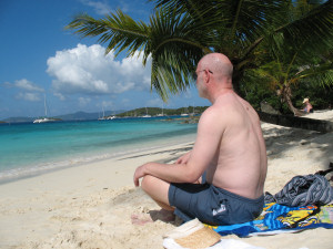 Photo: Michael Smith seated on a Caribbean beach - 2008