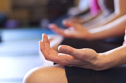 Photo: a relaxed hand rests on a knee during meditation