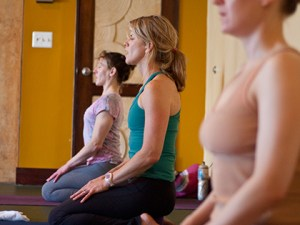 Photo: three yoginis seated in meditation at Thrive Yoga, Rockville