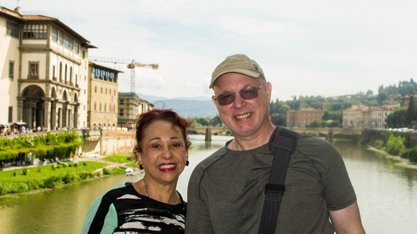 Photo: a couple stand on a bridge in Florence, Italy