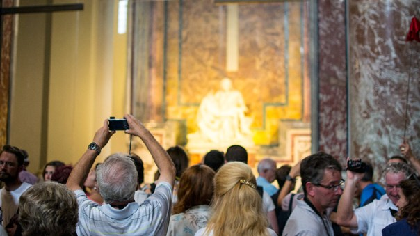 Photo: tourist crowd in from on Michelangelo's Pietà