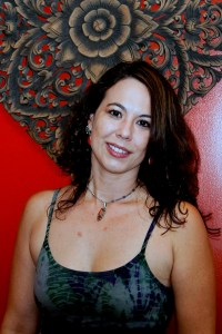 Photo: headshot of female teacher at yoga studio