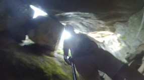 This snapshot from my video reveals the boulder stuck between two rock walls, giving an appearance of a ceiling