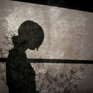 The silhouette of a young woman