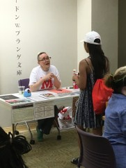 Professor Michele Mason, Director of CEAS, discusses about manga with visitors.