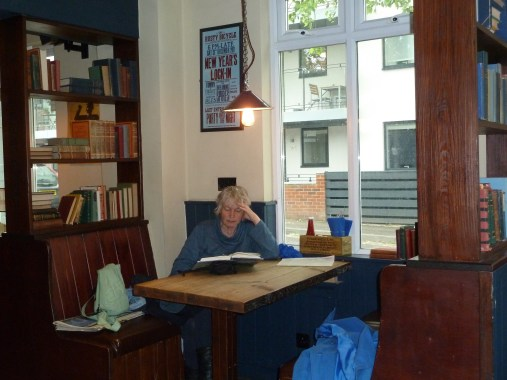 Carole reading at my favourite window table
