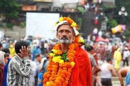 SADHU WITH THE MARIGOLD FLOWERS