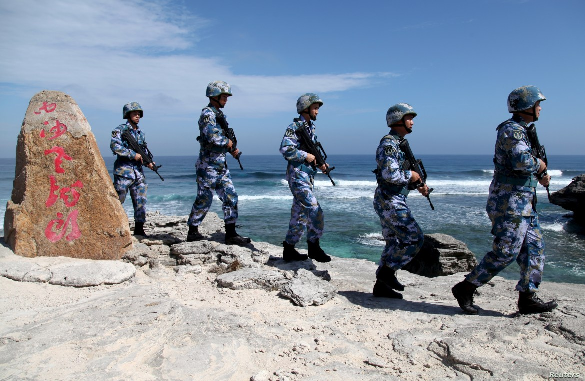 Soldiers of China's People's Liberation Army (PLA) Navy patrol at Woody Island, in the Paracel Archipelago, Jan. 29, 2016.