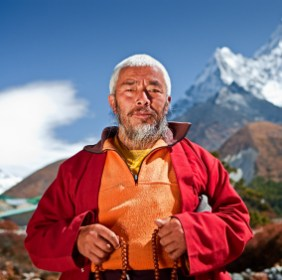 Buddhist monk on the background of Ama Dablam