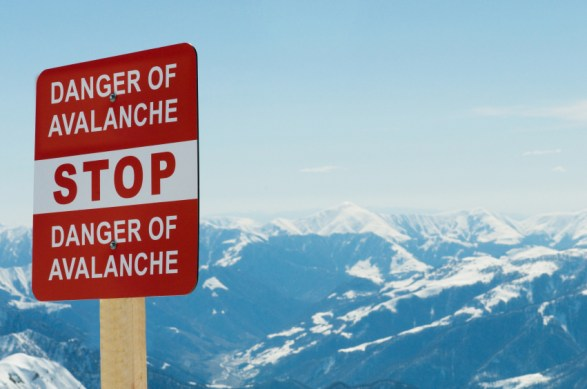 Avalanche sign and mountains at the background