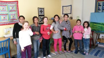 A girls' meeting in March that included a bracelet-making session.