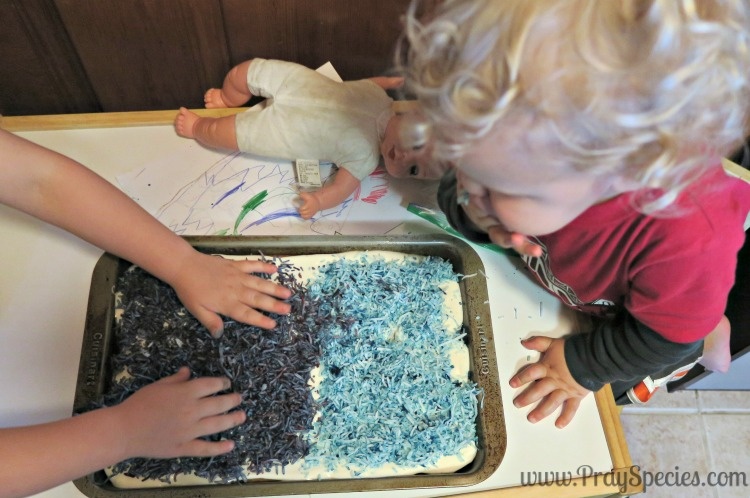 Grandma has this great idea to top the cake with coconut dyed to match the kids favorite colors: blue and purple. Love!