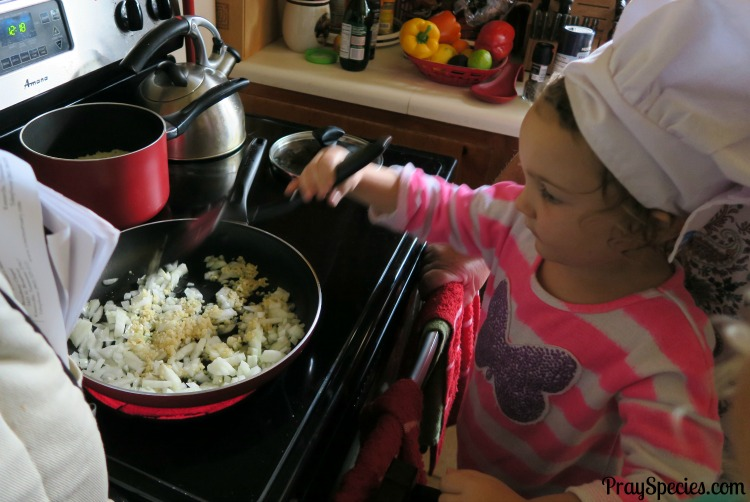 give your child the world cooking beans and rice