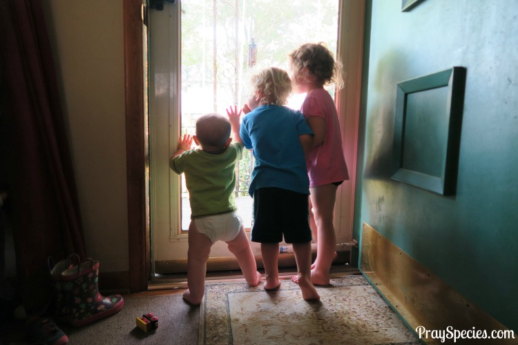 all-three-kids-looking-out-the-door