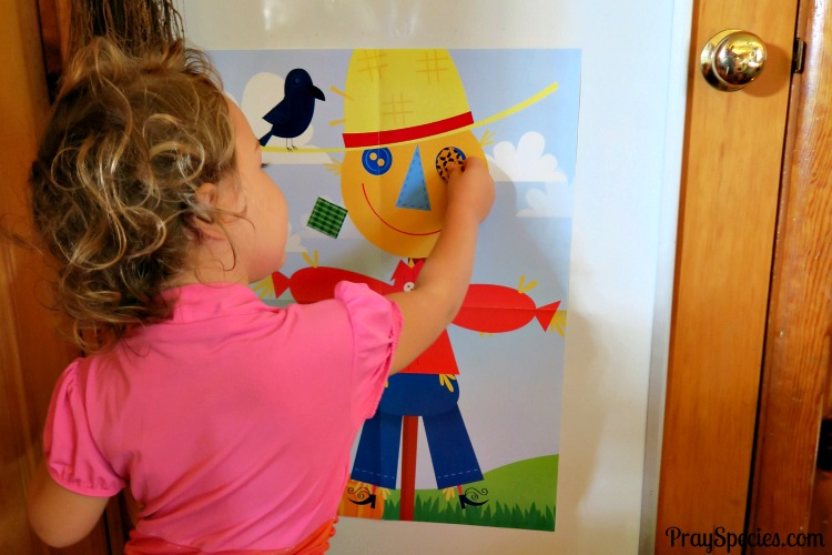 ladybug-pinning-the-patch-on-the-scarecrow