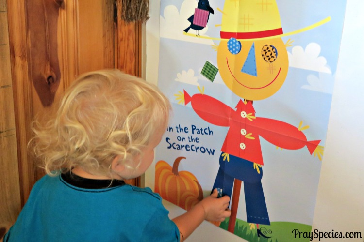 owl-pinning-the-patch-on-the-scarecrow