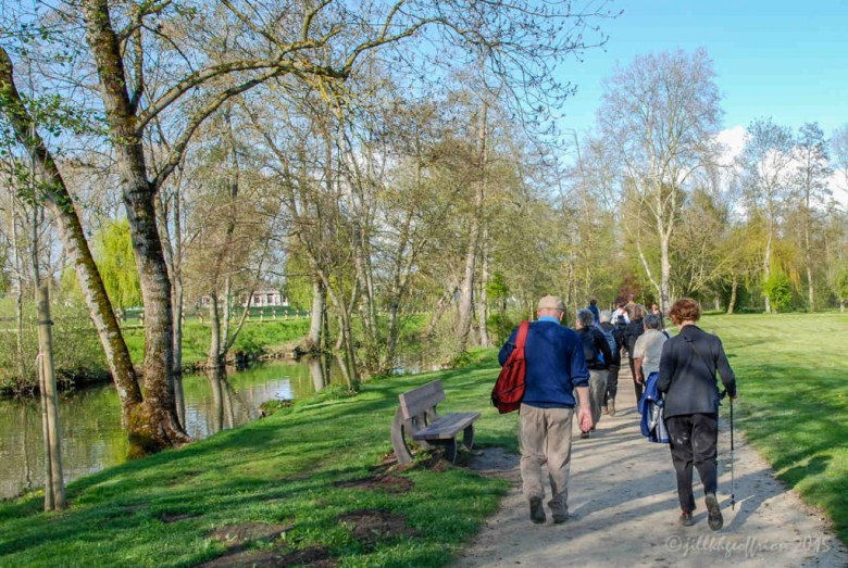 Pilgrims walking along the Eure River