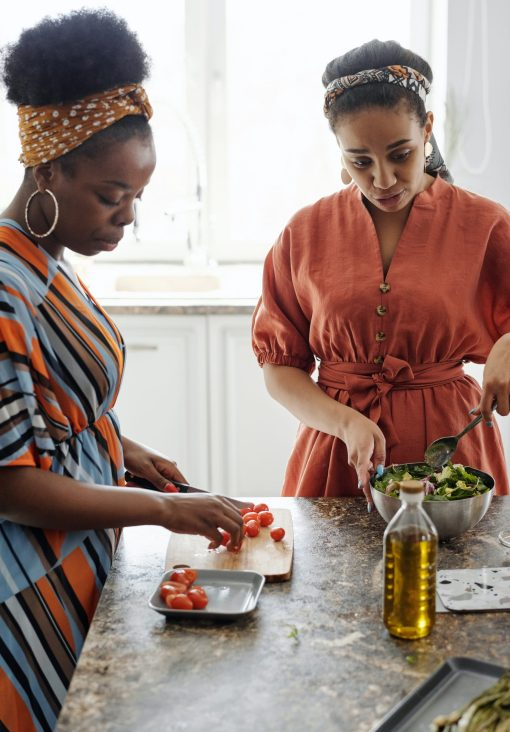 two women making a salad