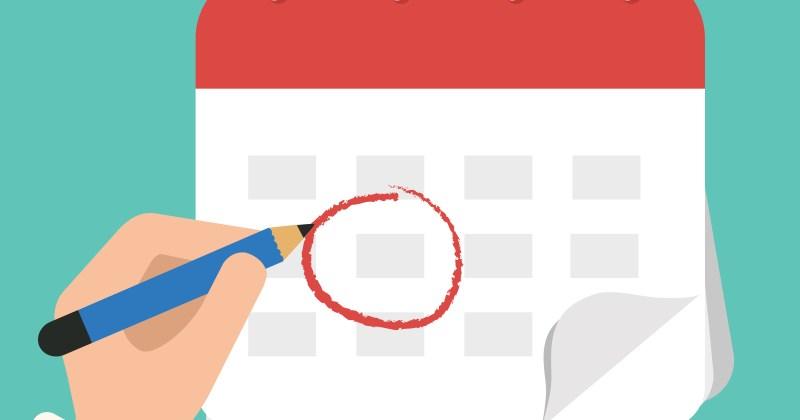 Hand marking a circle on a calendar